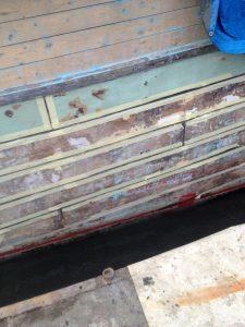 Caulking Wooden boat, mask the seams before caulking.