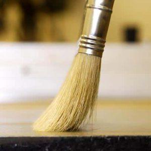 applying varnish thin varnish gentle brush stroke