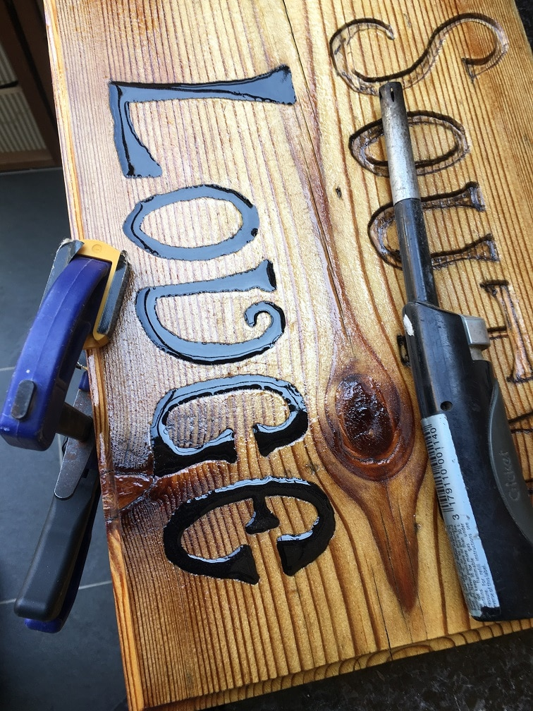 exterior wood signage burst bubbles in epoxy resin with heat