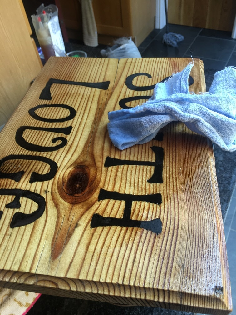 Exterior wooden sign apply light coat of clear penetrating epoxy sealer to make top coat stick